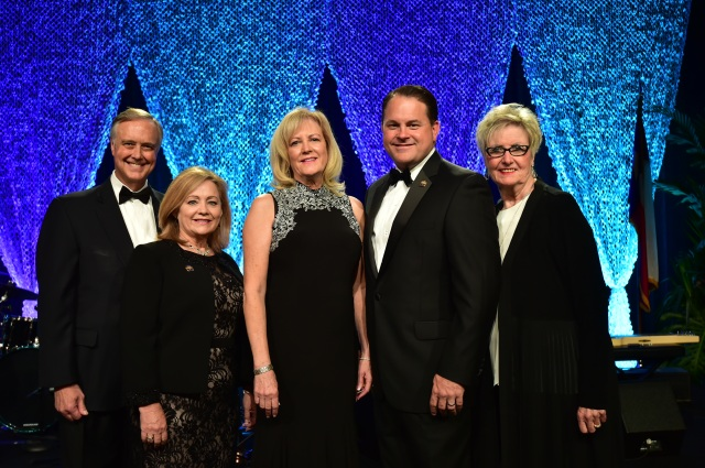 The 2018 TAR Leadership Team, from left to right, President/CEO Travis Kessler, Secretary/Treasurer Cindi Bulla, Chairman Kaki Lybbert, Chairman-elect Tray Bates, and Immediate Past Chairman Vicki Fullerton gather on stage before the Chairman's Installation at the 2017 Texas REALTORS® Conference.